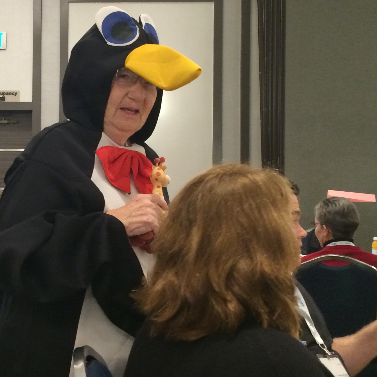 Ann Van Sant, Pediatric PT Journal Editor-in-Chief Emeritus, wears Penguin Suit to the CSM